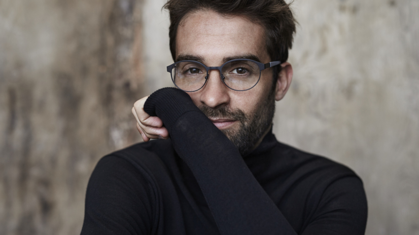 Spectacled guy in black sweater, portrait